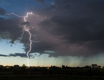 Lightning Strike in Neighborhood. An evening thunderstorm in Colorado. Lightning was plentiful during this storm and lots of it was hitting the ground near a Stock Image