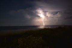 Lightning Strike at Ocean. Lightning strike at the ocean beach at night Royalty Free Stock Photo