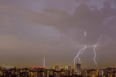 Lightning strike over city. Lightning strike over night city. Moscow, Russia Stock Photo