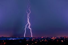 Lightning strike over dark blue sky Stock Image