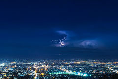 Lightning strike. Over dark sky on city Stock Image
