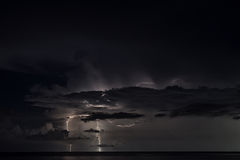 Lightning strike over the sea Stock Images
