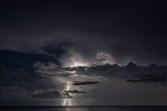 Lightning strike over the sea Stock Photography