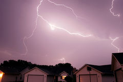 Lightning strike spanning the sky. Lightning bolt striking in the sky from clouds royalty free stock photography