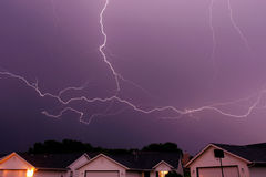 Lightning strike spanning the sky. Lightning bolt striking in the sky from clouds stock image