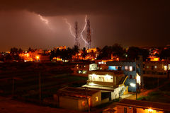 Lightning strike on telecommunications tower. Lightning strike on a two telecom towers at night Stock Images