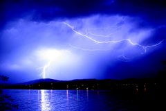 Lightning strikes. Dangerous thunderstorm with lightning striking royalty free stock photo