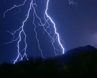 Lightning Strikes. Multiple lightning strikes on Black Mountain in the Arizona desert Royalty Free Stock Image