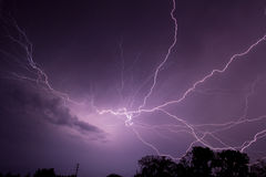 Lightning Strikes & Crosses the SKy. Lightning bolt with many branches cross the sky with in spectacular fashion Royalty Free Stock Image