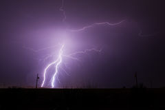 Lightning Strikes in Desert stock images