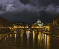 Lightning strikes the dome san pietro vatican rome. During a storm, lightning strikes the lightning rod of the dome of the church of Saint Petervatican rome Stock Photo