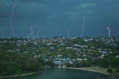 Lightning Strikes. Fork lightning strikes in Sydney Harbour Royalty Free Stock Photo