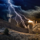 Lightning strikes fortress. Huge lightning from dark stormy sky strikes old fortress Royalty Free Stock Images