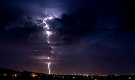 Lightning strikes. The ground above the town Royalty Free Stock Images