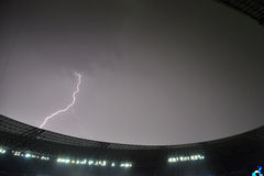Lightning strikes the roof of the stadium Royalty Free Stock Images