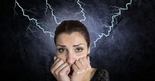 Lightning strikes and scared afraid woman. Digital composite of Lightning strikes and scared afraid woman Royalty Free Stock Photos