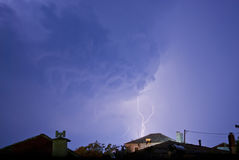 Lightning Strikes In Small Village. Thunderstorm with lightening at night Royalty Free Stock Images