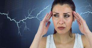 Lightning strikes and stressed woman with headache holding head. Digital composite of Lightning strikes and stressed woman with headache holding head Royalty Free Stock Photography