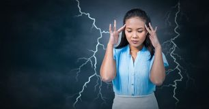 Lightning strikes and stressed woman with headache holding head. Digital composite of Lightning strikes and stressed woman with headache holding head Royalty Free Stock Photo