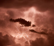 Lightning striking through clouds Royalty Free Stock Photo