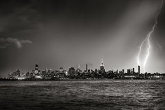 Lightning striking  New York City skyscraper at twilight Black & White Stock Photo
