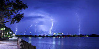 Lightning striking over bridge Royalty Free Stock Image