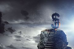 Concept of financial crisis. Mixed media. Lightning striking stone dollar sign. Mixed media Royalty Free Stock Photo