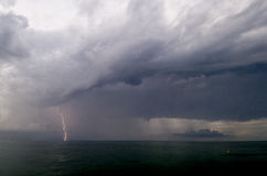 Lightning Strom Rolling in. Small lightning storm rolling in from ocean Stock Photo
