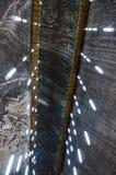 Lightning system in salt mine Turd, Cluj, Romania. Lamps in the salt mine Turd, Cluj, Romania- ceiling Stock Photo