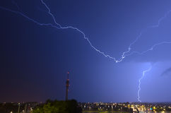 Lightning threatens telecommunications tower Royalty Free Stock Photos