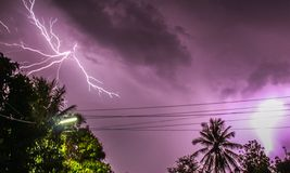 Lightning. Thunder and purple sky stock images