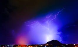 Lightning thunder storm above village Stock Images