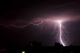 Lightning a thunderstorm. Nightly cloudy sky, background Royalty Free Stock Photo