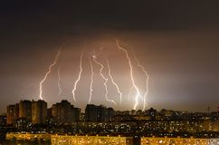 Lightning thunderstorm storm over the city at night. Royalty Free Stock Photo