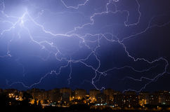 Lightning during thunderstorm in urban area at night Royalty Free Stock Photo