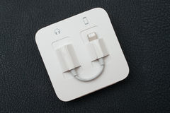 Lightning to 3.5 mm Headphone Jack Adapter and Earpods Royalty Free Stock Photo