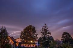 Lightning between trees Royalty Free Stock Photos