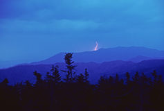 Lightning at Twilight in the mountains Stock Photos