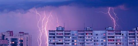 Lightnings. In the sky - evening rainy city landscape Royalty Free Stock Photo