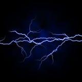 Lightnings. Electrical white blue lightnings over dark background Stock Image