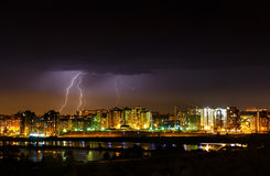 Lightnings in the night sky. Lightnings in the sky above city buildings in Irkutsk near river Angara Royalty Free Stock Images