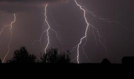 Lightnings and night thunderstorm stock photo
