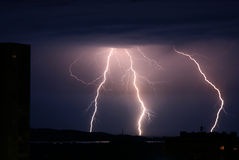Lightnings over city Stock Photo