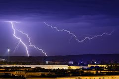 Lightnings over city in the night. A closer look on the lightnings during the storm in the night royalty free stock images