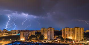 Lightnings Over Housing Estate Royalty Free Stock Images