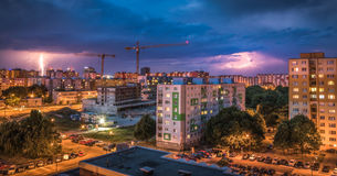 Lightnings Over Housing Estate. Night Storm in the City. Royalty Free Stock Photo