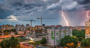 Lightnings Over Housing Estate. Storm in the City. Stock Photo