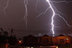 Lightnings over a residential area Royalty Free Stock Photo