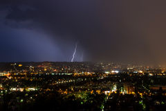 Lightnings over a town Stock Images