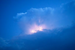 Lightnings in storm clouds. Peals of a thunder and the sparkling lightnings in clouds Royalty Free Stock Image